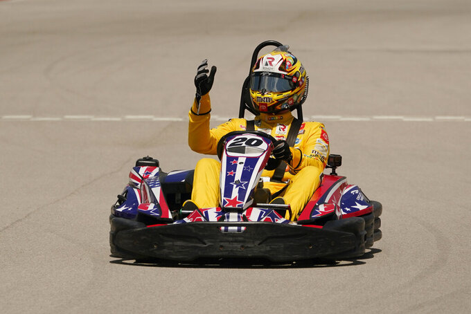 NASCAR Cup Series driver Kyle Busch waves as he rounds the Circuit of the Americas karting course, Monday, April 19, 2021, in Austin, Texas. NASCAR's inaugural race at Circuit of The Americas will be held the weekend of May 21-23. (AP Photo/Eric Gay)