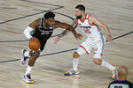 Sacramento Kings' Buddy Hield (24) drives around Houston Rockets' Austin Rivers (25) during the second half of an NBA basketball game Sunday, Aug. 9, 2020, in Lake Buena Vista, Fla. (AP Photo/Ashley Landis, Pool)