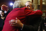 Harvard University president Drew Faust, left, embraces Lawrence Bacow after he was introduced Sunday, Feb. 11, 2018, in Cambridge, Mass., as the next president of the school. Bacow, former president of Tufts University and a leader-in-residence at Harvard's Kennedy School of Government, assumes the office as the school's 29th president on July 1. He will succeed Faust, 70, who has served in the post for more than a decade as Harvard's first female president. (AP Photo/Bill Sikes)