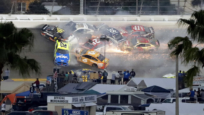 Multiple cars crash during a NASCAR Daytona 500 auto race on Feb. 17, 2019, at Daytona International Speedway in Daytona Beach, Fla. The crash included Austin Dillon (3), Daniel Suarez (41), David Ragan (38), Paul Menard (21), Ryan Newman (6), Aric Almirola (10), Matt DiBenedetto (95) and Ryan Blaney (12). (AP Photo/Chris O'Meara)
