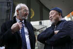 Chinese contemporary artist and activist Ai Weiwei speaks to John Shipton, biological father of Julian Assange outside the Old Bailey in support of Julian Assange's bid for freedom during his extradition hearing, in London, Monday, Sept. 28, 2020. (AP Photo/Kirsty Wigglesworth)