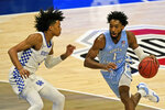 North Carolina's Leaky Black (1) drives past Kentucky's Brandon Boston Jr. (3) in the first half of an NCAA college basketball game, Saturday, Dec. 19, 2020, in Cleveland. North Carolina won 75-63. (AP Photo/Tony Dejak)