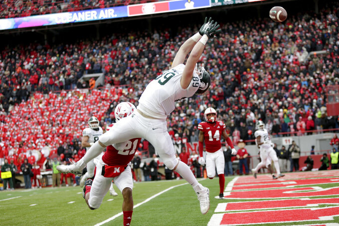 Michigan State tight end Matt Dotson (89) can't reach a pass in the end zone as Nebraska defensive back Lamar Jackson (21) defends, during the first half of an NCAA college football game in Lincoln, Neb., Saturday, Nov. 17, 2018. (AP Photo/Nati Harnik)