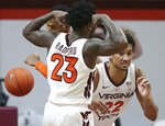 Virginia Tech's Tyrece Radford (23) and Keve Aluma (22) after a score in the second half of an NCAA  college basketball game in Blacksburg Va., Tuesday, Dec. 15, 2020.  (Matt Gentry/The Roanoke Times via AP, Pool)