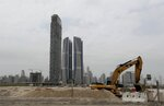 Damac towers are under construction in the Business Bay district of Dubai, United Arab Emirates, Tuesday, Feb. 11, 2020. One of Dubai's largest privately-owned developers, DAMAC Properties, is reporting $10 million in net loss last year. The loss comes as Dubai's leadership is beginning to look at ways to curb an oversupply of new properties on the market that's been compounded by an economic slowdown and job losses across the emirate, which is ramping up spending this year to host Expo 2020, the world's fair. (AP Photo/Kamran Jebreili)