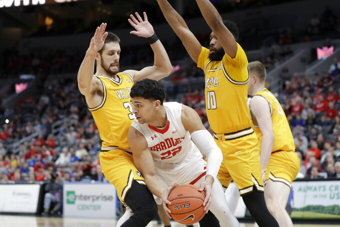 Bradley's Ja'Shon Henry (22) looks to pass as Valparaiso's John Kiser, left, and Eron Gordon (10) defend during the first half of an NCAA college basketball game in the championship of the Missouri Valley Conference men's tournament Sunday, March 8, 2020, in St. Louis. (AP Photo/Jeff Roberson)