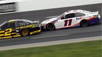 Drivers Brad Keselowski (2) and Denny Hamlin (11) race bumper-to-bumper during a NASCAR Cup Series auto race, Sunday, Aug. 2, 2020, at the New Hampshire Motor Speedway in Loudon, N.H. (AP Photo/Charles Krupa)