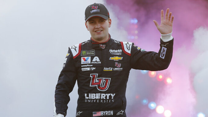 William Byron waves to fans during driver introductions prior to the start of the NASCAR Cup series auto race at Richmond Raceway in Richmond, Va., Saturday, April 13, 2019. (AP Photo/Steve Helber)