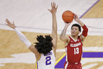 Alabama guard Jahvon Quinerly (13) shoots a 3-pointer in front of LSU forward Trendon Watford (2) in the first half of an NCAA college basketball game in Baton Rouge, La., Tuesday, Jan. 19, 2021. (AP Photo/Brett Duke)