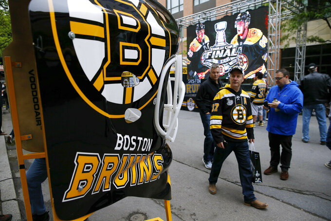 Fans arrive for Game 2 of the NHL hockey Stanley Cup Final between the St. Louis Blues and the Boston Bruins, Wednesday, May 29, 2019, in Boston. (AP Photo/Michael Dwyer)