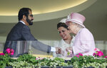 FILE - In this Wednesday, June, 15, 2016 file photo,  Britain's Queen Elizabeth II, right, greets Sheikh Mohammed Bin Rashid Al Maktoum, UAE Vice President and the Ruler of Dubai and his wife Princess Haya of Jordan in the royal box on the second day of the Royal Ascot horse race meeting at Ascot, England. A legal battle between the powerful, poetry-writing ruler of Dubai and his wealthy estranged wife is leading toward a showdown in a London courtroom later this month. The family division court case scheduled on July 30, 2019 pits Sheikh Mohammed bin Rashid Al Maktoum against Princess Haya, daughter of the late King Hussain of Jordan and an accomplished Olympic equestrian on friendly terms with horse aficionado Queen Elizabeth II. (AP Photo/Alastair Grant, File)