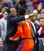 Clemson's Marcquise Reed (2) runs into North Carolina State coach Kevin Keatts, left, after chasing a loose ball during the first half of an NCAA college basketball game in Raleigh, N.C., Saturday, Jan. 26, 2019. (AP Photo/Ben McKeown)