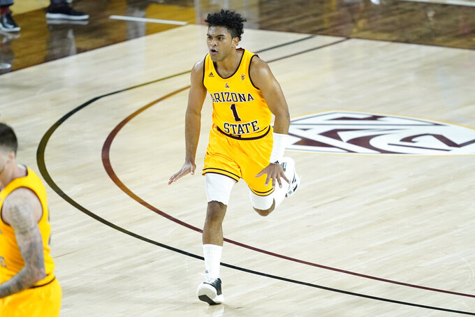 Arizona State guard Remy Martin (1) celebrates a basket against Oregon State during the first half of an NCAA college basketball game, Sunday, Feb. 14, 2021, in Tempe, Ariz.(AP Photo/Matt York)