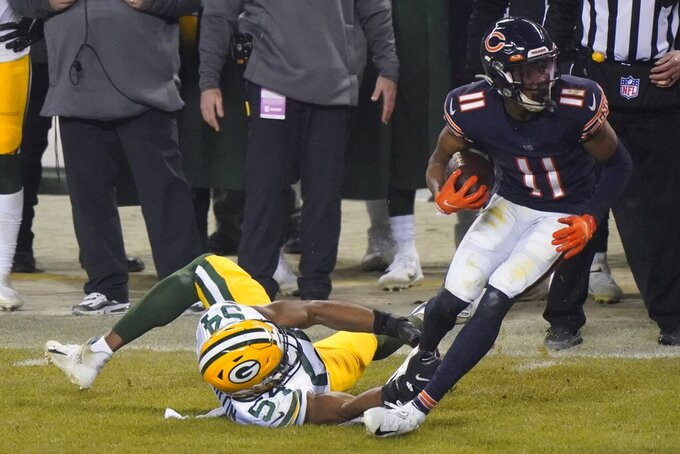 Green Bay Packers' Kamal Martin tries to stop Chicago Bears' Darnell Mooney during the second half of an NFL football game Sunday, Jan. 3, 2021, in Chicago. (AP Photo/Nam Y. Huh)