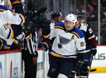 St. Louis Blues right wing Vladimir Tarasenko, right, is congratulated as he passes the team box after scoring a goal against the Colorado Avalanche in the third period of an NHL hockey game Saturday, Feb. 16, 2019, in Denver. The Blues won 3-0. (AP Photo/David Zalubowski)