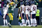 Green Bay Packers' Aaron Rodgers celebrates after Aaron Jones ran for a touchdown during the second half of an NFL football game against the Chicago Bears Sunday, Dec. 15, 2019, in Green Bay, Wis. (AP Photo/Mike Roemer)