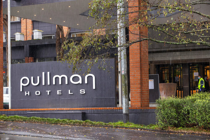 Security patrol outside the Pullman Hotel in Auckland, New Zealand, July 6, 2020. Health officials in New Zealand say Monday, Jan. 25, 2021, that genome tests indicate the country's most recent COVID-19 patient contracted the virus from another returning traveler just before leaving quarantine. (Peter Meecham/New Zealand Herald via AP)