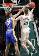 Miami forward Sam Waardenburg, right, is fouled by Pittsburgh forward Terrell Brown, left, during the first half of an NCAA college basketball game, Sunday, Jan. 12, 2020, in Coral Gables, Fla. (AP Photo/Lynne Sladky)