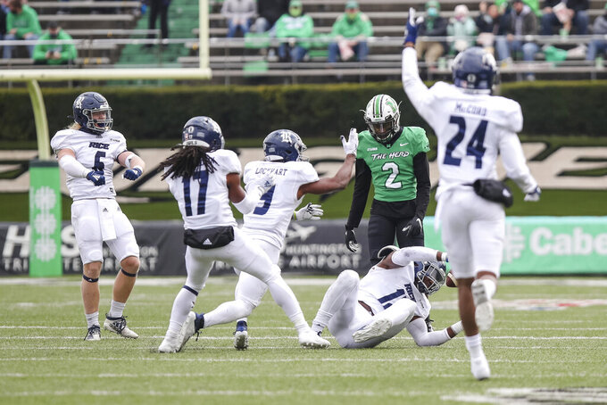 Rice players celebrate an interception around Marshall wide receiver Artie Henry (2) during an NCAA college football game on Saturday, Dec. 5, 2020, in Huntington, W.Va.  (Sholten Singer/The Herald-Dispatch via AP)