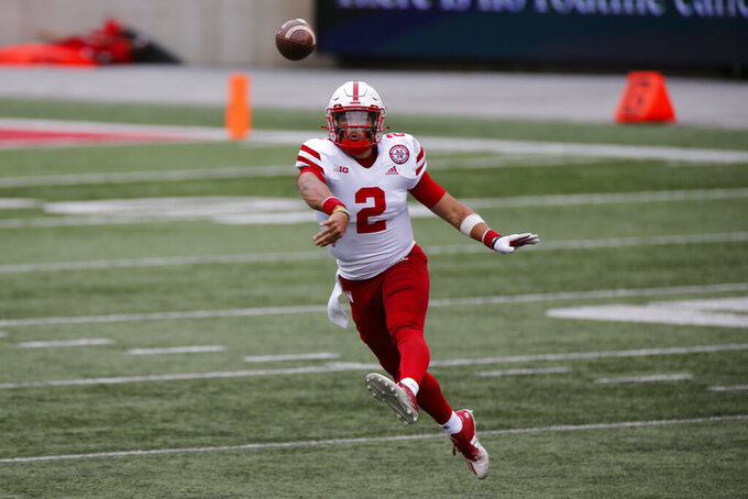 Nebraska quarterback Adrian Martinez throws a pass against Ohio State during the second half of an NCAA college football game Saturday, Oct. 24, 2020, in Columbus, Ohio. Ohio State defeated Nebraska 52-17. (AP Photo/Jay LaPrete)