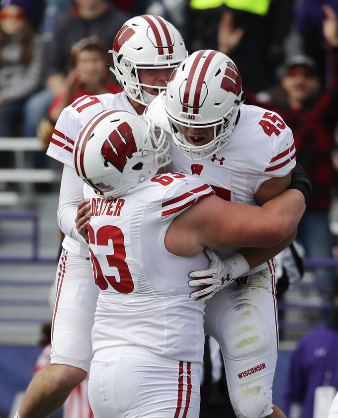Wisconsin fullback Alec Ingold (45) celebrates with left guard Michael Deiter (63) and quarterback Jack Coan (17) after scoring a touchdown against Northwestern during the first half of an NCAA college football game in Evanston, Ill., Saturday, Oct. 27, 2018. (AP Photo/Nam Y. Huh)