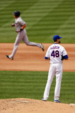 New York Mets pitcher Jacob deGrom (48) reacts after giving up a solo home run to Miami Marlins' Garrett Cooper  as Cooper rounds ther bases during the sixth inning of a baseball game on Monday, Aug. 31, 2020, in New York. (AP Photo/Adam Hunger)