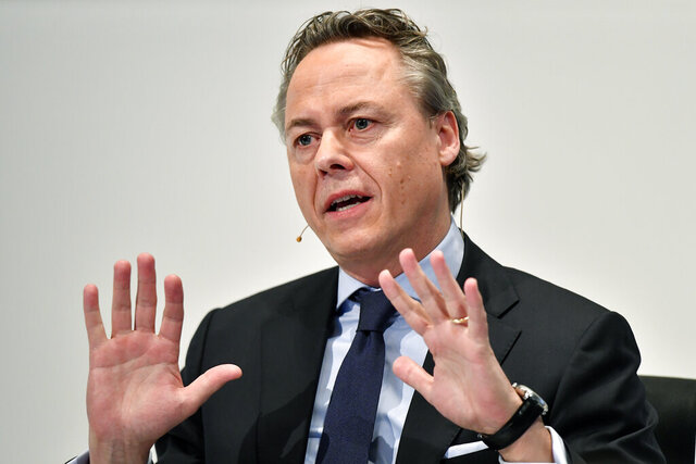 FILE - In this Thursday, Feb. 20, 2020 file photo, Ralph Hamers, new CEO of Swiss Bank UBS, gestures during a press conference in Zurich, Switzerland. A Dutch court ruled Wednesday, Dec. 9, 2020, that Hamers, the former CEO of ING bank, should face a criminal investigation for his role in a money laundering scandal that led to a huge settlement in 2018. (Walter Bieri/Keystone via AP, File)