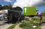 Police gather outside the Anisio Jobim Prison Complex after a deadly riot erupted among inmates in Manaus in the northern state of Amazonas, Brazil, Sunday, May 26, 2019. A statement from the state prison secretary says prisoners began fighting among themselves around noon Sunday, and security reinforcements were rushed to complex. (AP Photo/Edmar Barros)