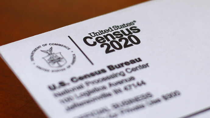FILE - This April 5, 2020, file photo shows an envelope containing a 2020 census letter mailed to a U.S. resident in Detroit. The Supreme Court's decision to allow the Trump administration to end the 2020 census was another case of whiplash for the census, which has faced stops from the pandemic, natural disasters and court rulings. (AP Photo/Paul Sancya, File)