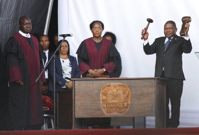 Mozambique's President Filipe Nyusi, right, during his inauguration ceremony in Maputo, Mozambique, Wednesday, Jan. 15, 2020. Nyusi has been sworn in for a second and final term after five turbulent years in office amid two armed insurgencies. (AP Photo/Ferhat Momade)