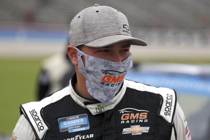 NASCAR Texas Trucks Series driver Brett Moffitt (23) stands on pit road before a NASCAR Cup Series auto race at Texas Motor Speedway in Fort Worth, Texas, Sunday, Oct. 25, 2020. (AP Photo/Richard W. Rodriguez)
