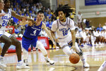 UCLA guard Tyger Campbell (10) gets past BYU guard Alex Barcello (4) during the first half of an NCAA college basketball game, Monday, Nov. 25, 2019, in Lahaina, Hawaii. (AP Photo/Marco Garcia)