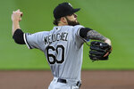 Chicago White Sox's Dallas Keuchel throws in the first inning during a baseball game against the Cincinnati Reds in Cincinnati, Saturday, Sept. 19, 2020. (AP Photo/Aaron Doster)