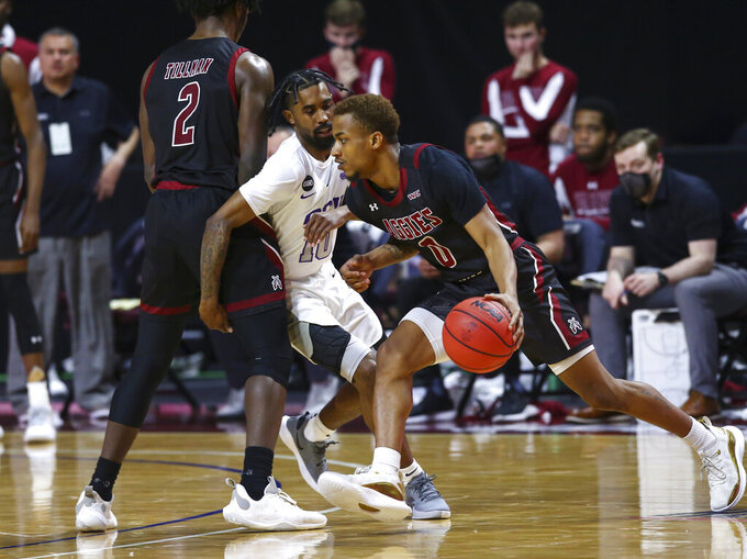 New Mexico State's C.J. Roberts (0) drives the ball around Grand Canyon's Jovan Blacksher Jr. (10) during the second half of an NCAA college basketball game for the championship of the Western Athletic Conference men's tournament Saturday, March 13, 2021, in Las Vegas. (AP Photo/Chase Stevens)