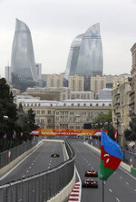 FILE - In this Saturday, April 28, 2018 file photo, cars race during the third free practice session at the Baku Formula One city circuit, in Baku, Azerbaijan. The Formula One race will be held on Sunday. Baku renewed its contract on Tuesday Feb. 5, 2019, to host Formula One's Azerbaijan Grand Prix through 2023, prolonging the stay of a circuit which initially struggled for acceptance but has since become a fan favorite. (AP Photo/Luca Bruno, File)