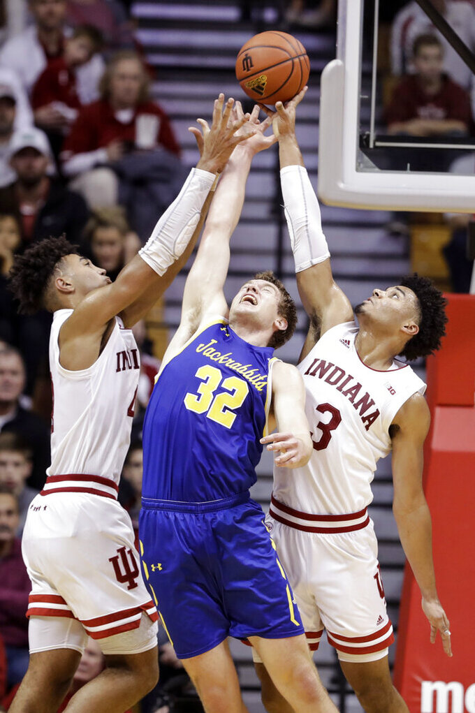South Dakota State's Matt Dentlinger (32) battles for rebound against Indiana's Trayce Jackson-Davis (4) and Justin Smith (3) during the second half of an NCAA college basketball game, Saturday, Nov. 30, 2019, in Bloomington, Ind. (AP Photo/Darron Cummings)