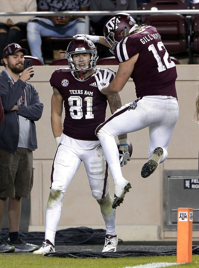 Texas A&M tight end Jace Sternberger (81) gets a pat on the head from fullback Cullen Gillaspia (12) after Sternberger's touchdown against UAB during the second half of an NCAA college football game Saturday, Nov. 17, 2018, in College Station, Texas. (AP Photo/Michael Wyke)