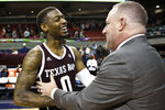 Texas A&M guard Jay Jay Chandler (0) celebrates the win over Auburn with Texas A&M head coach Buzz Williams after an NCAA college basketball game Wednesday, March 4, 2020, in Auburn, Ala. (AP Photo/Julie Bennett)