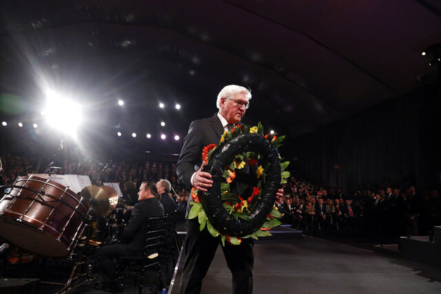 German President Frank-Walter Steinmeier takes part in a wreath-laying ceremony at the World Holocaust Forum marking 75 years since the liberation of the Nazi extermination camp Auschwitz, at Yad Vashem Holocaust memorial centre in Jerusalem, Thursday, Jan. 23, 2020. (Ronen Zvulun, Pool via AP)