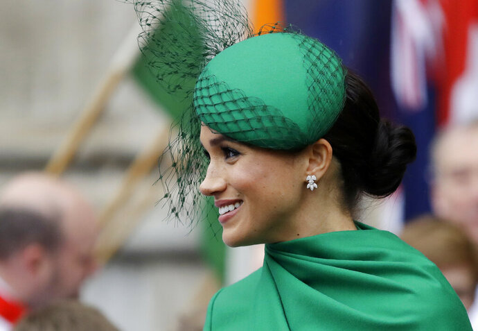 FILE - In this Monday, March 9, 2020 file photo, Britain's Meghan, the Duchess of Sussex leaves after attending the annual Commonwealth Day service at Westminster Abbey in London. A lawyer for the publisher of the Daily Mail newspaper said Wednesday Jan. 20, 2021, that the Duchess of Sussex had no reasonable expectation of privacy for a letter she sent her estranged father. The former Meghan Markle is suing publisher Associated Newspapers for invasion of privacy and copyright infringement over five February 2019 articles in the Mail on Sunday and on the MailOnline website that published portions of a handwritten letter to her father, Thomas Markle, after her marriage to Britain's Prince Harry in 2018. (AP Photo/Kirsty Wigglesworth, File)