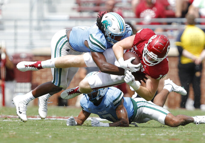 Tulane linebacker Dorian Williams (2) tackles Oklahoma tight end Austin Stogner (18) on a drive in the fourth quarter during a NCAA college football game Saturday, Sept. 4, 2021, in Norman, Okla. (AP Photo/Alonzo Adams)