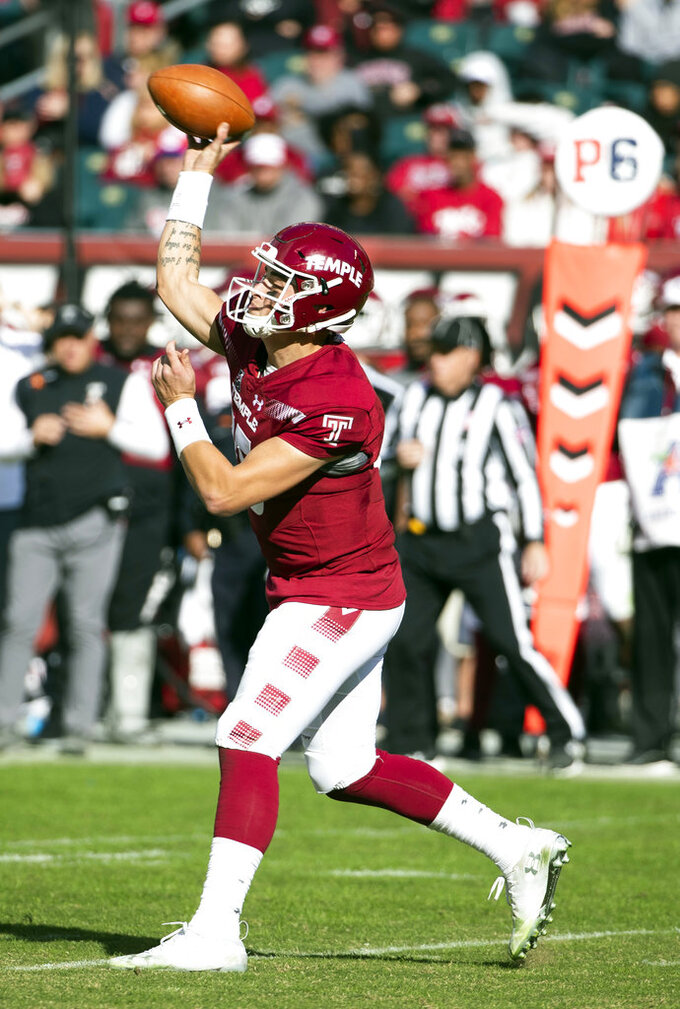 Temple's quarterback Anthony Russo (15) throws a pass during the second half of an NCAA college football against Cincinnati, Saturday, Oct. 20, 2018, in Philadelphia. Temple won 24-17 in overtime. (AP Photo/Chris Szagola)