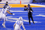 Boise State quarterback Cade Fennegan (8) looks for a receiver as the BYU defense closes in during the first half of an NCAA college football game Friday, Nov. 6, 2020, in Boise, Idaho. (AP Photo/Steve Conner)