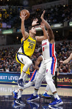 Indiana Pacers forward Doug McDermott (20) shoots over Detroit Pistons center Andre Drummond (0) during the second half of an NBA basketball game in Indianapolis, Friday, Nov. 8, 2019. The Pacers won 112-106. (AP Photo/Michael Conroy)