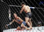 Henry Cejudo, right, knocks down TJ Dillashaw during the first round of a flyweight mixed martial arts championship bout at UFC Fight Night, early Sunday, Jan. 20, 2019, in New York. Cejudo stopped Dillashaw in the first round. (AP Photo/Frank Franklin II)
