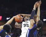 Tulsa forward Jeriah Horne (41) stops UCF forward Collin Smith (35) during an NCAA college basketball game in Orlando on Saturday, Jan. 19, 2019. (Stephen M. Dowell/Orlando Sentinel via AP)