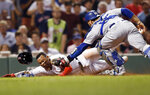 Los Angeles Dodgers' Russell Martin (55) tags out Boston Red Sox's Rafael Devers at home plate during the fifth inning of a baseball game in Boston, Sunday, July 14, 2019. (AP Photo/Michael Dwyer)