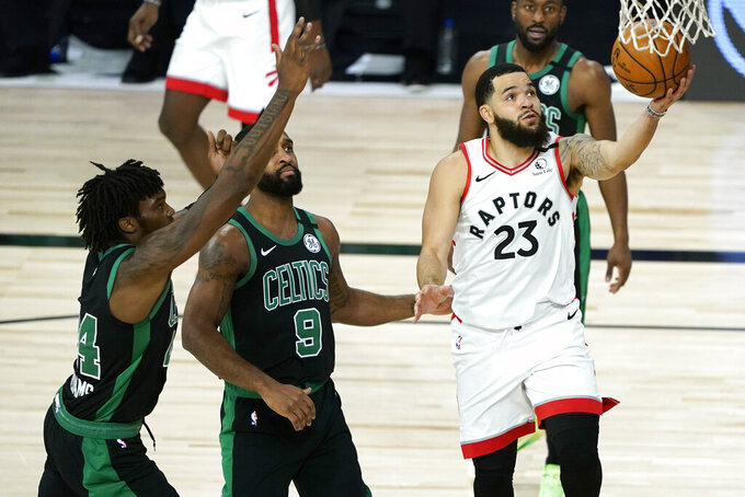 Toronto Raptors' Fred VanVleet (23) scores ahead of Boston Celtics' Brad Wanamaker (9) during the first half of an NBA basketball conference semifinal playoff game Sunday, Aug. 30, 2020, in Lake Buena Vista, Fla. (AP Photo/Ashley Landis)