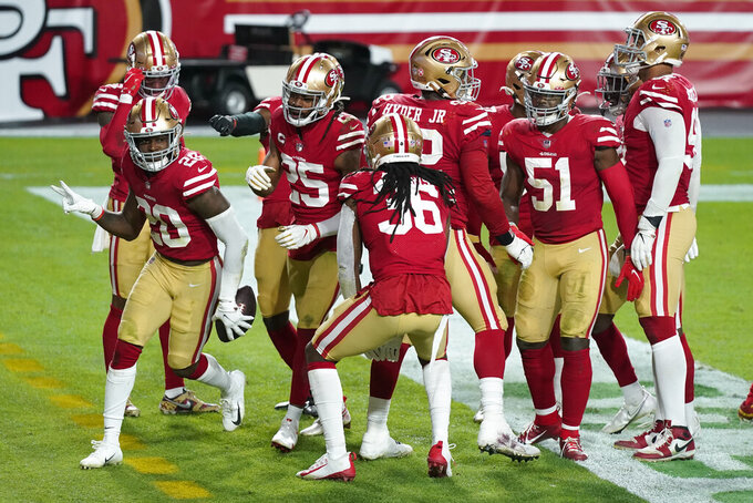 San Francisco 49ers free safety Jimmie Ward (20) celebrates his interception with teammates during the second half of an NFL football game, Sunday, Dec. 13, 2020, in Glendale, Ariz. (AP Photo/Ross D. Franklin)