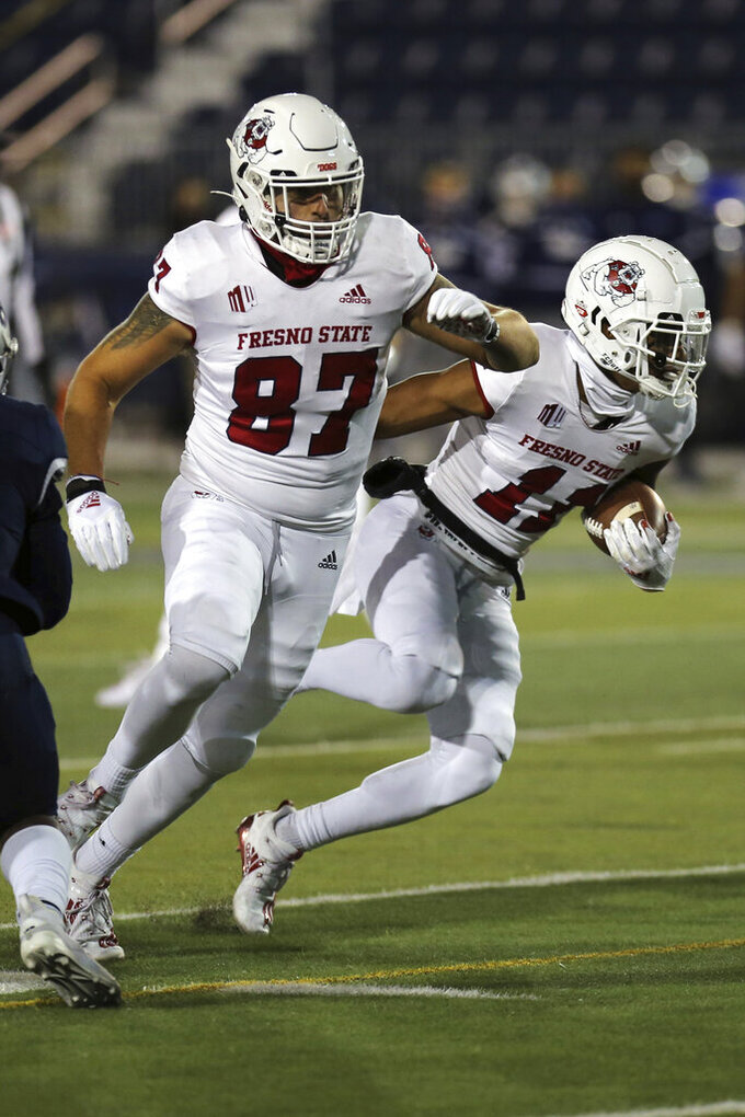 Fresno State wide receiver Michael Martens (87) left blocks for wide receiver L.J. Reed (11) on the way to Reed's touchdown against Nevada during the first half of an NCAA college football game Saturday, Dec. 5, 2020, in Reno, Nev. (AP Photo/Lance Iversen)